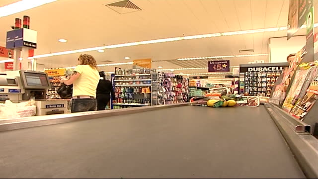 sainsbury to use biodegradable packaging supermarket general views goods on conveyor at checkout towards the camera / 'compostable' logo on packaging - packaging stock videos & royalty-free footage