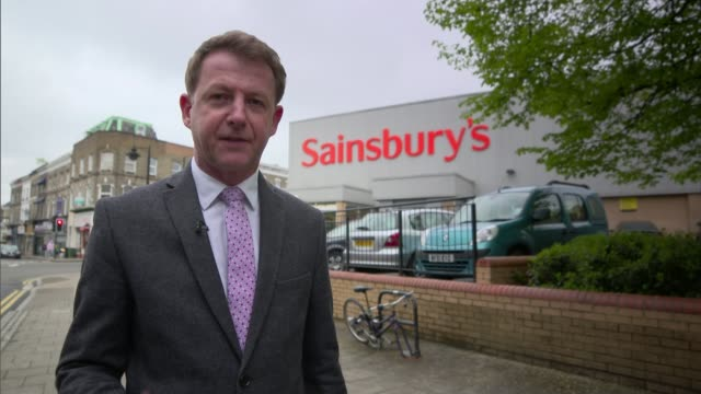 Sainsbury's and Asda announce merger plans ENGLAND EXT Reporter to camera