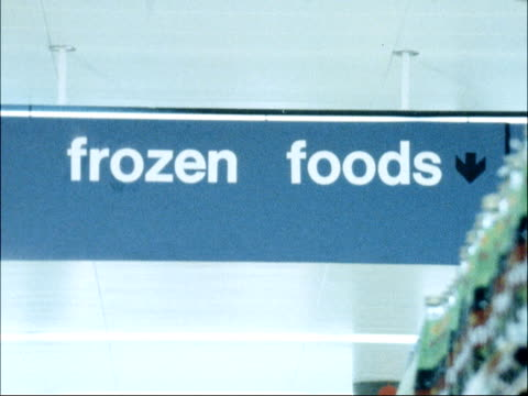 sainsbury's install special computer system to control use of energy; england: kent: maidenhead: int shoppers in store across aisle 'frozen foods'... - frozen food stock videos & royalty-free footage