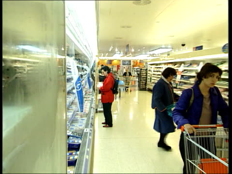 Sainsbury's Jobs axed after poor profit rise ITN London i/c Workers in Sainsbury's supermarket placing goods on shelves Childs and Dominic Fry along...