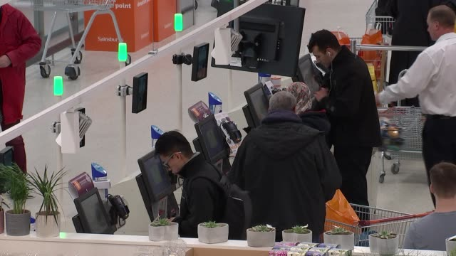 sainsbury's supermarket general views high angle gvs of supermarket floor and customers using self service tills / 'prices lowered' sign / fruit... - self service stock videos & royalty-free footage