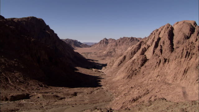 saint catherine's monastery lies nestled in a barren gorge in mount sinai egypt. available in hd. - sinai egitto video stock e b–roll