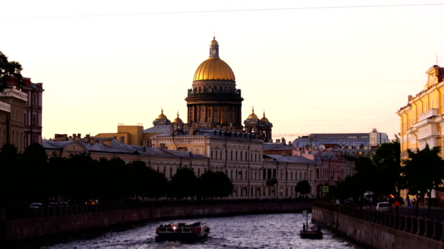 saint isaac cathedral across moyka river in st. petersburg, russia - cathedral stock videos & royalty-free footage