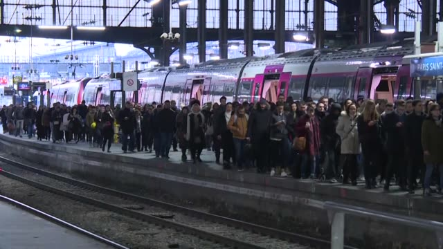 saint lazare station in central paris was packed with passengers this morning as commuters head back to work after the holidays - head back stock videos & royalty-free footage
