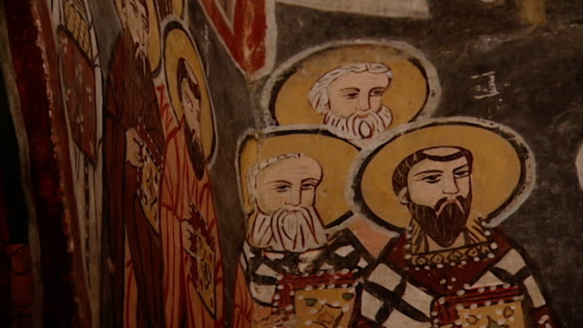 saint moses the abyssinian monastery. low-angle of a fresco depicting saints, in the monastery church. saint moses the abyssinian is a monastic... - circa 11th century stock videos & royalty-free footage