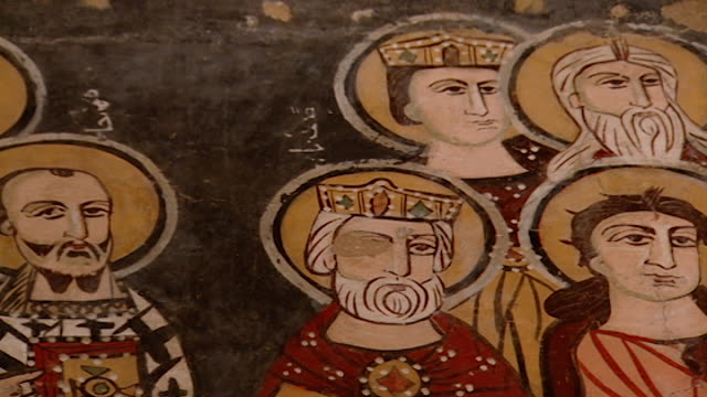 saint moses the abyssinian monastery. low-angle pan-left of a medieval fresco depicting saints, in the monastery church. saint moses the abyssinian... - circa 11th century stock videos & royalty-free footage