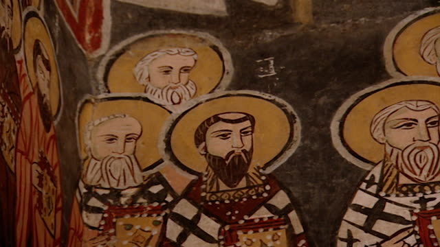 saint moses the abyssinian monastery. low-angle pan-right of a fresco depicting saints, in the monastery church. saint moses the abyssinian is a... - circa 11th century stock videos & royalty-free footage