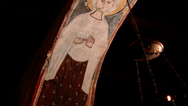 saint moses the abyssinian monastery. low-angle tilt-down of a fresco painted on the inside of an arch in the monastery church. saint moses the... - circa 11th century stock videos & royalty-free footage