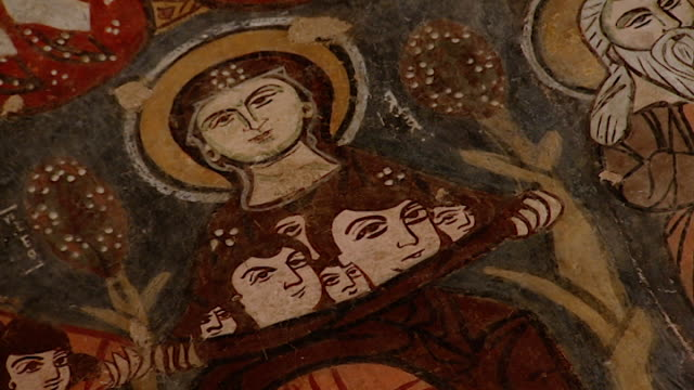 saint moses the abyssinian monastery. mcu view of a medieval fresco depicting depicting a female saint, in the monastery church. saint moses the... - circa 11th century stock videos & royalty-free footage