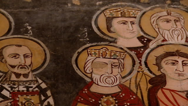 saint moses the abyssinian monastery. slow low-angle pan-left of a medieval fresco depicting saints, in the monastery church. saint moses the... - circa 11th century stock videos & royalty-free footage