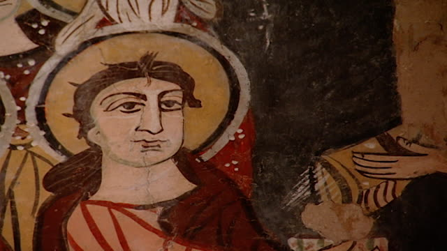 saint moses the abyssinian monastery. view of a medieval fresco depicting depicting a saint, in the monastery church. saint moses the abyssinian is a... - circa 11th century stock videos & royalty-free footage
