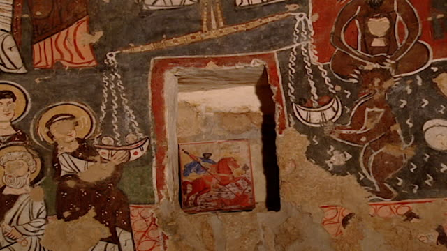 saint moses the abyssinian monastery. view of medieval frescoes depicting scales between good and evil over a painting of saint george and the... - circa 11th century stock videos & royalty-free footage