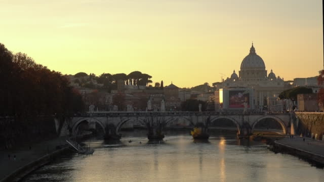 saint peter basilica and tevere river at sunset - ken burns stock videos and b-roll footage