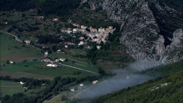 saint-auban and mountain mist  - aerial view - provence-alpes-côte d'azur, france - overhead projector stock videos & royalty-free footage