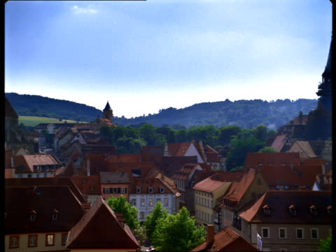 Saints Peter and George Cathedral and the Altes Rathaus rise above Bamberg, Germany.