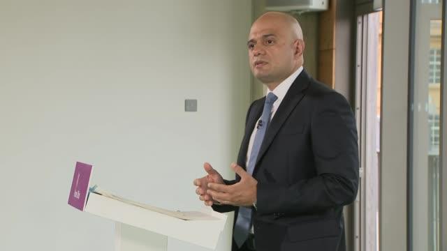 sajid javid warns that racism is fuelling populist politicians; england: london: int sajid javid mp speech sot cutaways javid at podium various of... - ポピュリズム点の映像素材/bロール