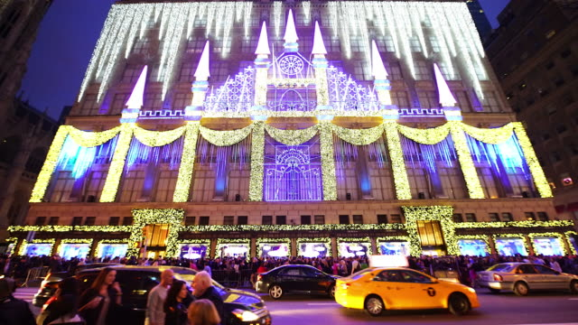 Saks Fifth Avenue department is decorated and illuminated by Christmas lights along 5th Avenue in midtown Manhattan People are watching the...