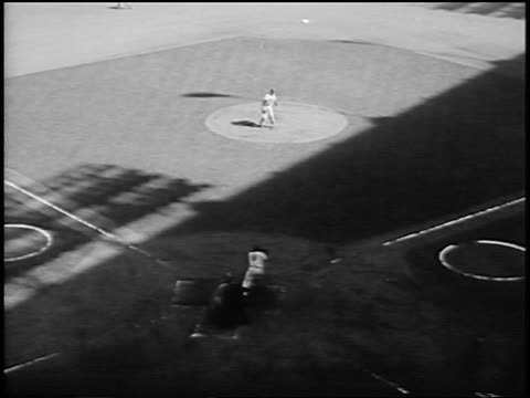 vídeos de stock e filmes b-roll de sal maglie pitching to yogi berra / duke snider catching ball in outfield / world series - 1956