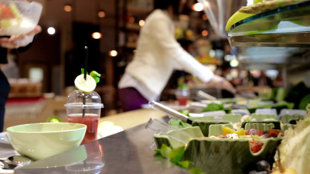 salad bar, handheld shot - buffet stock videos & royalty-free footage
