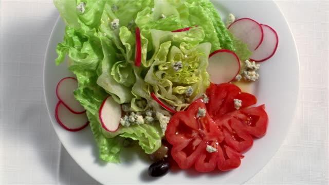 cu salad on plate - salad stock videos and b-roll footage