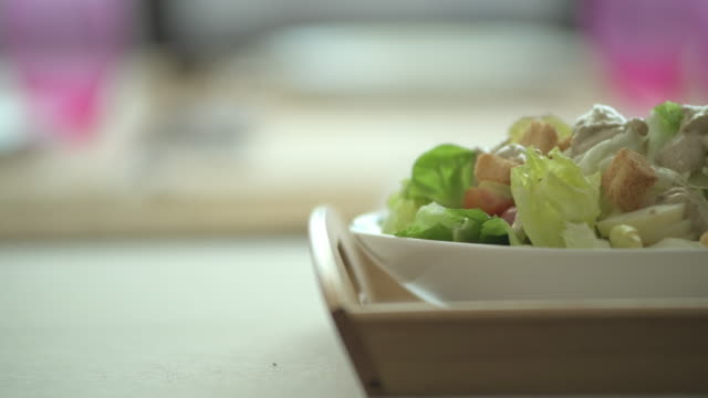 salad on table, candid style. - thanksgiving plate stock videos & royalty-free footage