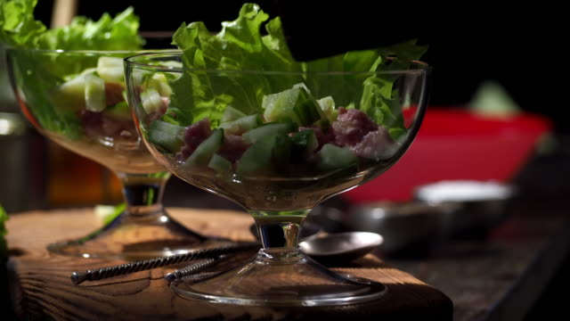 salad with tuna, grapefruit and salmon roe - chopped lettuce stock videos & royalty-free footage