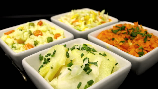 salate in schüsseln - zahl 4 stock-videos und b-roll-filmmaterial