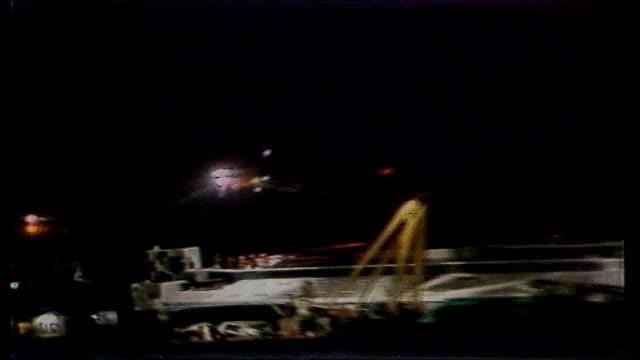 stockvideo's en b-roll-footage met over 1000 feared dead file / tx 6397 originally from 8387 belgium off zeebrugge various shots of stricken ferry 'herald of free enterprise' on it's... - ramp veerboot zeebrugge 1987