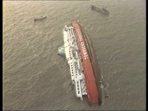 over 1000 feared dead; file / tx 8.3.87 belgium: off zeebrugge: night air views stricken ferry 'herald of free enterprise' on it's side in water - passenger craft stock videos & royalty-free footage