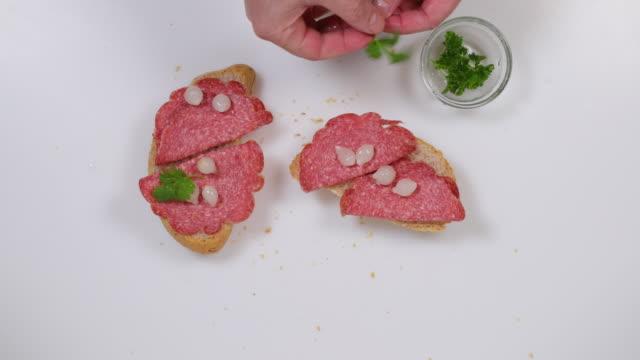 salami sandwich garnishing. - parsley video stock e b–roll