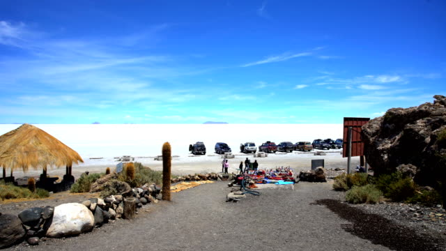 salar de uyuni 4x4 carrying tourists on trip - bolivia stock videos & royalty-free footage