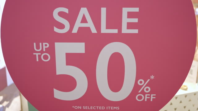 sale 50 percent discount sign in front of shop - discount shop stock videos & royalty-free footage