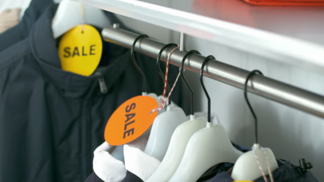 HD DOLLY: Sale Clothes Hanging On Hangers
