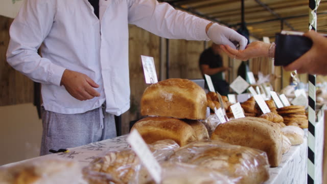 sale on bread stall at farmers market - bakery stock videos and b-roll footage