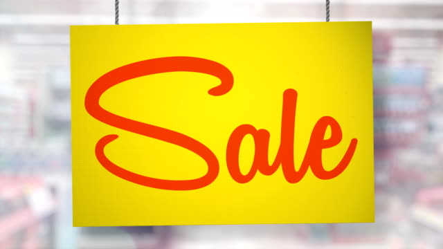 sale sign hanging from ropes. luma matte included so you can put your own background. - sale stock videos & royalty-free footage