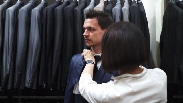 sales assistant helping man - dinner jacket stock videos & royalty-free footage