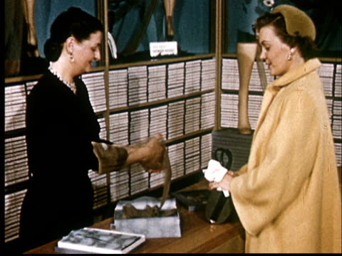 ms, sales assistant showing  stockings to customer at department store - unterwäsche stock-videos und b-roll-filmmaterial