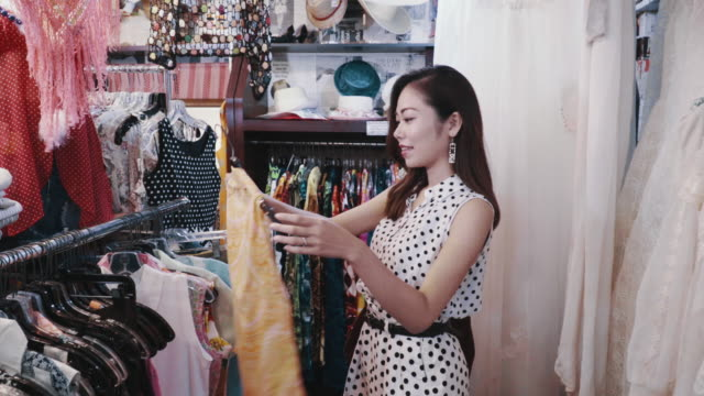 sales clerk assisting a customer in a thrift store - east asia stock videos & royalty-free footage