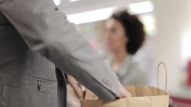 sales clerk working at grocery store - protective workwear stock-videos und b-roll-filmmaterial