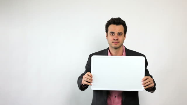 sales guy holding white board, being silly. - banner sign stock videos and b-roll footage