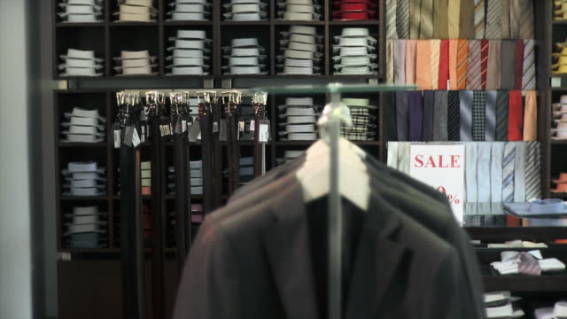 hd: sales in a clothing store - clothing stock videos & royalty-free footage