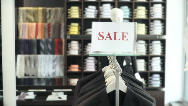hd: sales in a clothing store - clothes shop stock videos & royalty-free footage