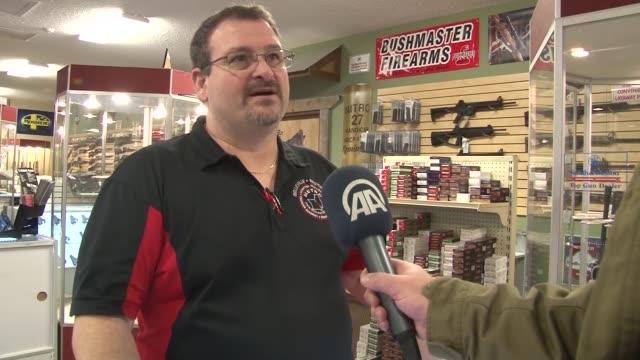sales increased at gun shops near ferguson ahead of awaited grand jurys decision in washington, united states on 17 november, 2014. - 銃器店点の映像素材/bロール