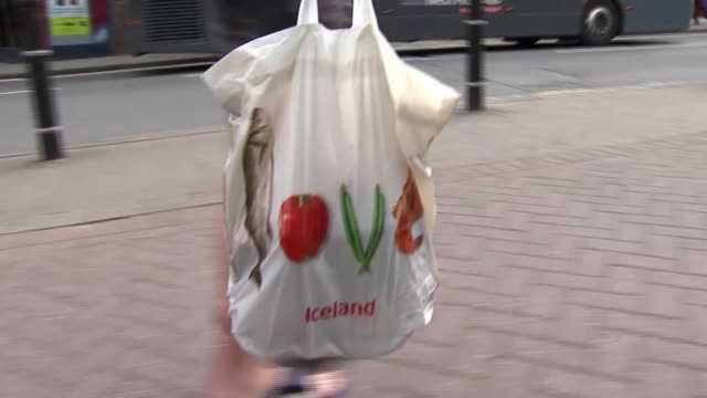 sales of plastic carrier bags plummet after introduction of 5p charge; england: birmingham: ext various of reusable carrier bags being carried along... - bag stock videos & royalty-free footage