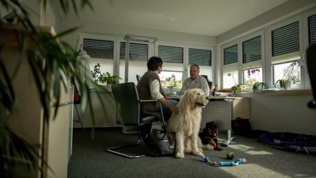 Sales talk in an insurance broker's office