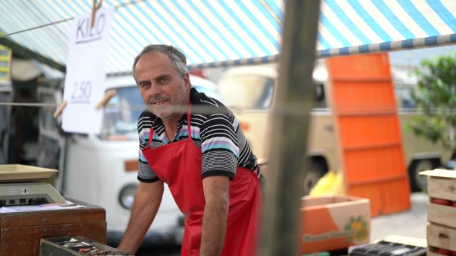salesman at farmer's market - agricultural fair stock videos & royalty-free footage
