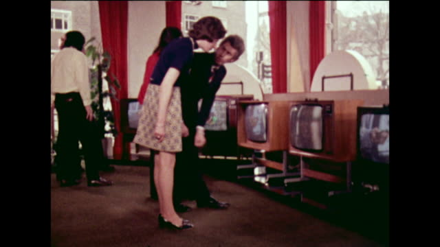 salesman demos a television to a woman in a shop; 1973 - new stock videos & royalty-free footage