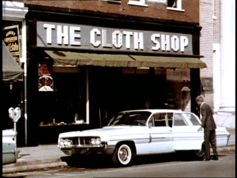 / salesman disappointingly exits 'the cloth shop' retail store / traveling salesman pulls away from the curb and cuts off an oncoming car, almost... - salesman stock videos & royalty-free footage