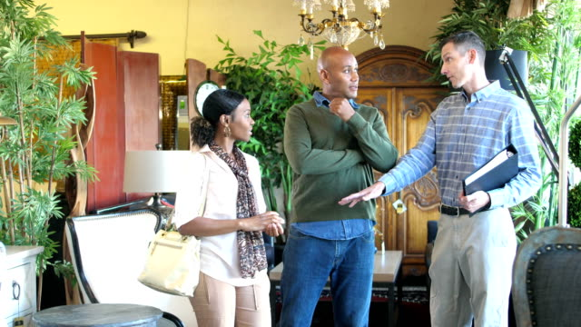 salesman helping african-american couple buy furniture - furniture stock videos & royalty-free footage