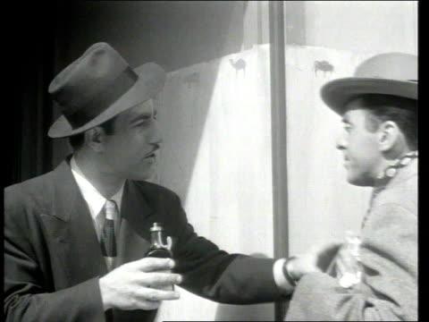 1945 montage a salesman selling medicine - strategia di vendita video stock e b–roll